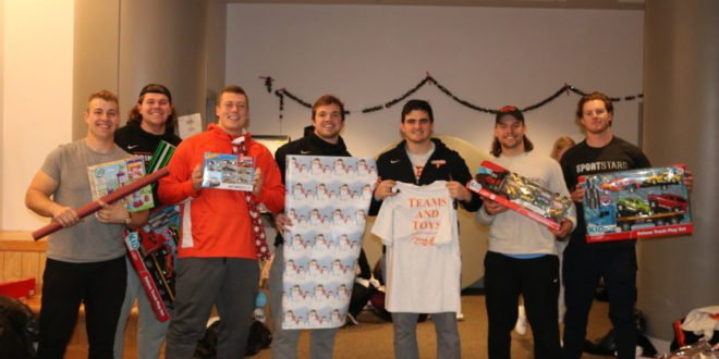 Student-Athletes Bring Holiday Cheer Through Teams & Toys